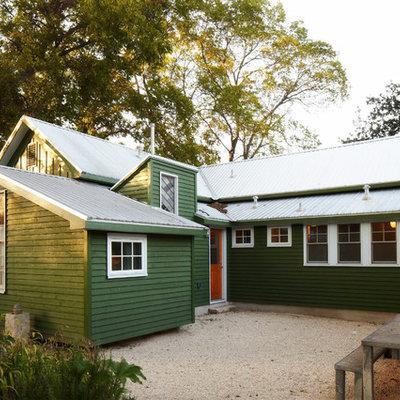 Farmhouse green exterior home photo in Austin