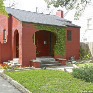Inspiration for a small mediterranean red one-story stucco exterior home remodel in Austin