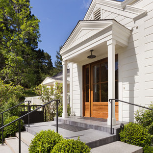 Example of a transitional white one-story wood gable roof design in San Francisco