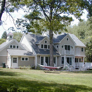 Large traditional gray two-story wood gable roof idea in New York