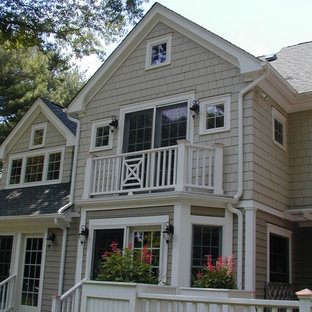 Large elegant gray two-story wood gable roof photo in New York