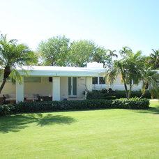 Tropical Exterior 1950's ranch home