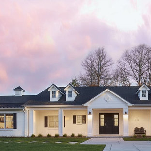 Example of a large classic white one-story brick exterior home design in Denver with a shingle roof