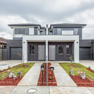 Design ideas for a contemporary two-storey brick grey duplex exterior in Melbourne with a hip roof.