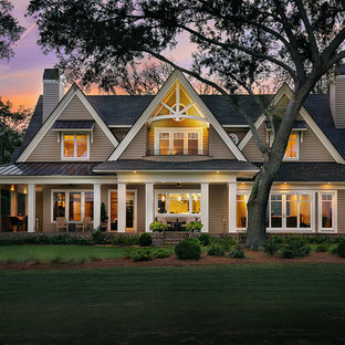 Inspiration for a timeless brown two-story exterior home remodel in Charleston with a shingle roof