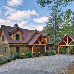 Example of a mountain style green three-story mixed siding exterior home design in Other with a shingle roof