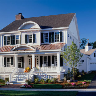 Example of a mid-sized classic two-story wood exterior home design in New York with a mixed material roof