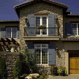 Mediterranean stone exterior home idea in Denver