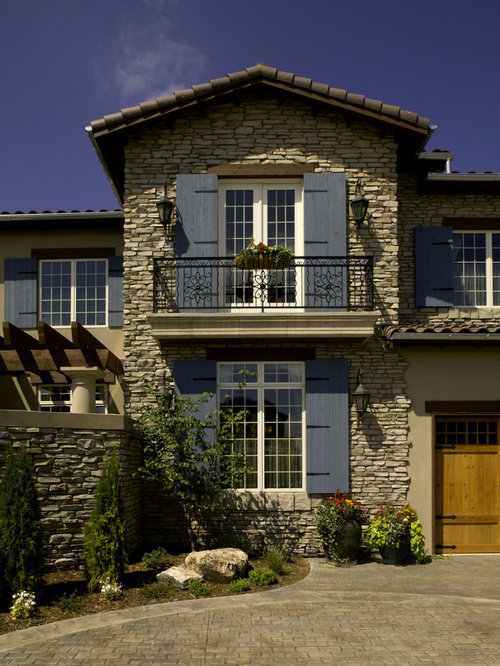 Stone shutters houzz for Mediterranean stone houses