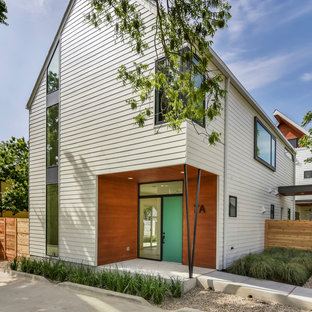 Mid-sized modern white two-story concrete fiberboard exterior home idea in Austin with a shingle roof
