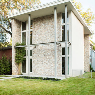 Design ideas for a contemporary two floor exterior in Atlanta with mixed cladding.