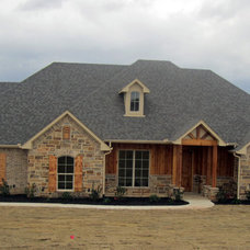Traditional Exterior by Anthony Builders