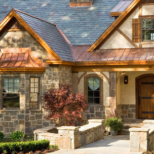 Mountain style stone exterior home photo in New York