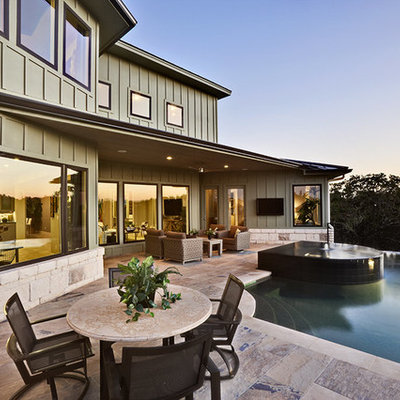 Example of a trendy green exterior home design in Austin