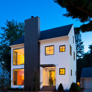 Inspiration for a transitional wood gable roof remodel in Minneapolis
