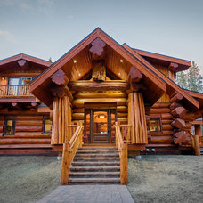 Rustic Exterior by Mountain Log Homes & Interiors