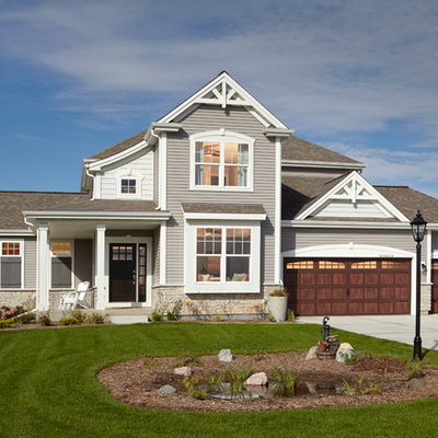 Mid-sized traditional gray two-story mixed siding exterior home idea in Milwaukee