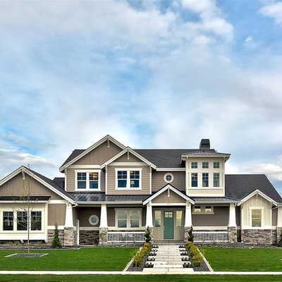 Large elegant brown two-story mixed siding gable roof photo in Boise