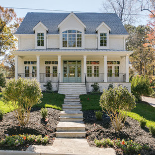 Inspiration for a country white two-story gable roof remodel in Raleigh