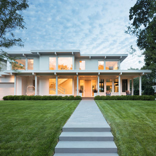 Inspiration for a contemporary white two-story flat roof remodel in Minneapolis