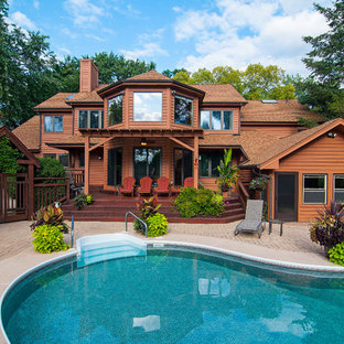 Rustic brown two-story exterior home idea in Chicago with a shingle roof