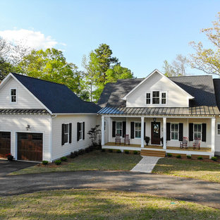 Cottage white one-story gable roof photo in Other with a shingle roof