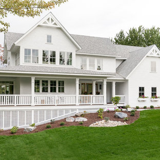 Traditional white two-story exterior home idea in Minneapolis with a shingle roof
