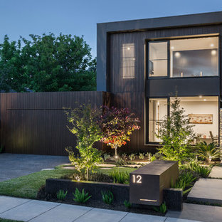 Contemporary two-storey brown house exterior in Melbourne with mixed siding and a flat roof.
