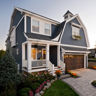 Inspiration for a mid-sized craftsman blue two-story vinyl house exterior remodel in New York with a gambrel roof and a shingle roof
