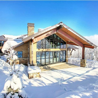 Inspiration for a rustic brown wood gable roof remodel in Salt Lake City