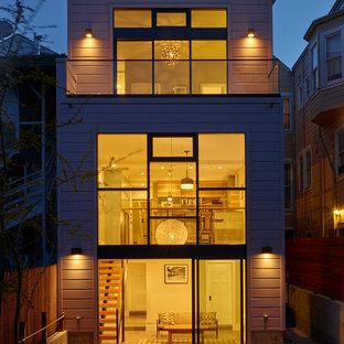 Inspiration for a large contemporary beige three-story wood flat roof remodel in San Francisco