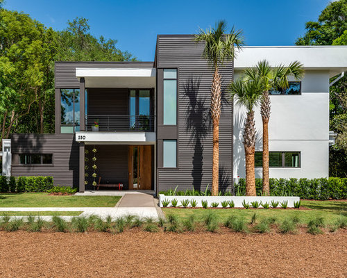 Trendy White Two Story Flat Roof Photo In Orlando