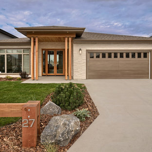 Photo of a contemporary one floor exterior in Other with stone cladding.
