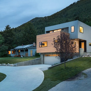 Inspiration for a mid-sized contemporary three-story mixed siding flat roof remodel in Other