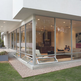 Example of a minimalist two-story exterior home design in Austin