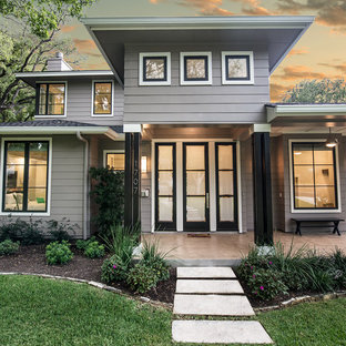Transitional gray two-story wood exterior home photo in Austin