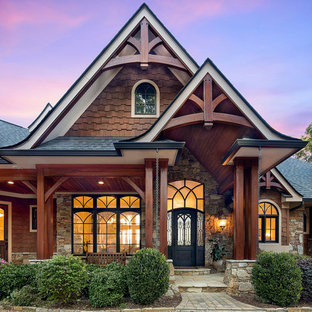 Elegant brown two-story mixed siding exterior home photo in Other with a shingle roof