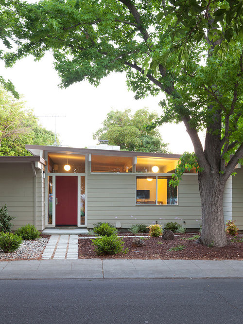 Example of a midcentury modern one-story wood exterior home design in San  Francisco with