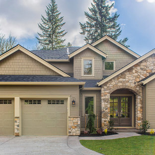 Example Of A Transitional Brown Two Story Mixed Siding Exterior Home Design  In Portland With