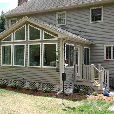 Huge traditional gray two-story concrete fiberboard exterior home idea in Boston with a clipped gable roof