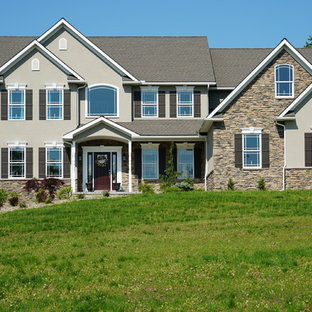 Example of a transitional gray two-story mixed siding exterior home design in Other
