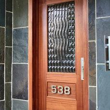 Modern Exterior by Sculptural Glass Doors Inc