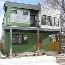 Contemporary Exterior by elite construction designs