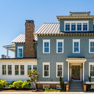 Beach style green two-story mixed siding exterior home idea in Other with a metal roof