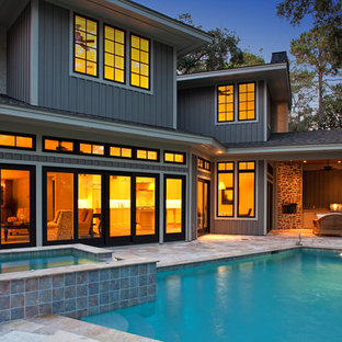 Inspiration for a large transitional gray two-story mixed siding exterior home remodel in Atlanta