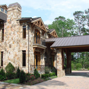 Elegant stone exterior home photo in Houston