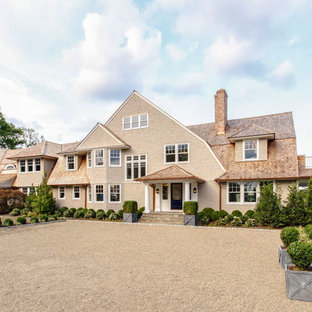 Example of a huge coastal gray two-story wood house exterior design in New York with a gambrel roof and a shingle roof