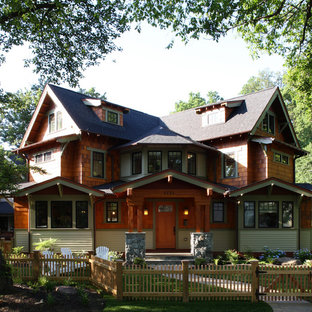 Large craftsman three-story wood exterior home idea in Seattle