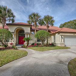 "14355 Paradise Tree Dr. Orlando, Fl 32828 - Traditional sale. This lovingly cared for & well maintained home is now available & is in move-in ready condition! Located in the popular Avalon Park community, this 5 bedroom, 3 bath home has tons of upgrades. The many features include lots of windows for a bright open floor plan, formal living/dining areas, separate family room, downstairs master suite & a large beautiful kitchen with all appliances included. The eat-in kitchen features gorgeous 42"" cherry cabinets with under counter lighting, ceramic tile flooring, island, walk in pantry, tile back splash, breakfast bar & separate breakfast area. The large spa-like master bath features lots of tile, dual sinks, separate garden tub & shower. Other features include upstairs balcony, alarm system, crown molding, chair railing, arched doorways, decorative columns, tray ceilings, track lighting, surround sound in family room, thermal windows with blinds, architectural shingle roof & rear entry 3 car garage with electronic door opener. The over-sized screened patio area has a covered porch great for entertaining. Conveniently located to UCF, Valencia, Research Parkway, Lockheed Martin, Siemens, Medical City, Lake Nona, Burnham Institute, award winning Avalon Park, Waterford Lakes Town Center & minutes from the 528, 417 & 408. Avalon Park features community parks, swimming pools, tennis and basketball courts, banking, shopping, dining, fountains, waterways, top rated nationally recognized schools & is a great neighborhood for biking, jogging & walking."