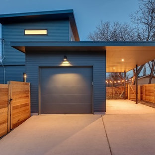 Mid-sized mid-century modern gray two-story wood exterior home photo in Austin with a green roof
